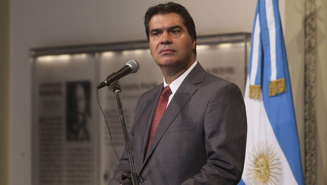 Government minister Jorge Capitanich during a press conference in Buenos Aires, Argentina, Monday.