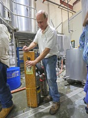 Brew master Jack Wick pours a fresh beer at Twin Lakes Brewery in Newport.