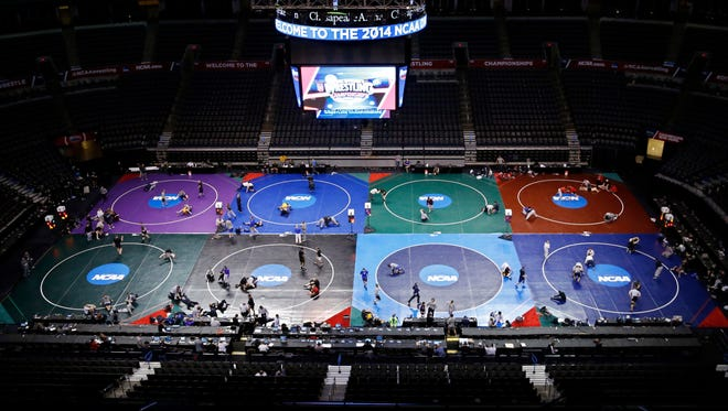 Wrestlers prepare for the NCAA college wrestling championships in Oklahoma City, Wednesday, March 19, 2014. Competition begins March 20.
