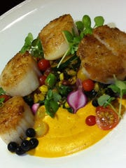 Seared scallops ($38) at Trend Kitchen are done perfectly and nicely, though not cutely.