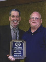Co-Chairman Kevin Smith (left) presents Brian Gandy with the J. Malcolm Beebe Service Award during the 68th annual Millville Elks Lodge No. 580 Sports Frolic, which was held on Feb. 1.