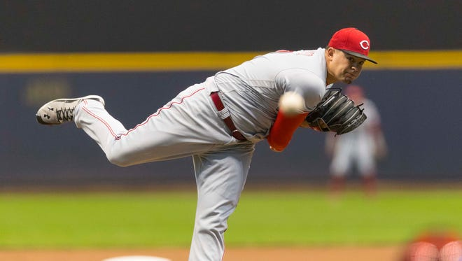 Cincinnati Reds pitcher Sal Romano (47) throws a pitch during the first inning against the Milwaukee Brewers at Miller Park.