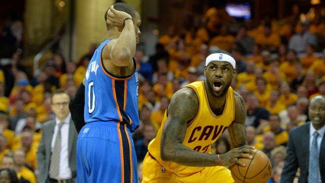 LeBron James looks to shoot against Russell Westbrook.