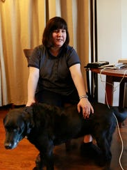 "Joanne Stark pats her guide dog ""Ditra"" Thursday at"