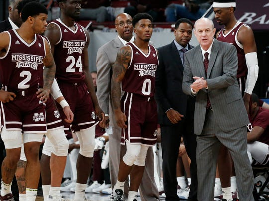 Mississippi State head coach Ben Howland, right, and his players ready themselves to enter the floor following a time out against Mississippi in the first half of an NCAA college basketball game, Saturday, Jan. 12, 2019 in Starkville, Miss. Mississippi won 81-77. (AP Photo/Rogelio V. Solis)
