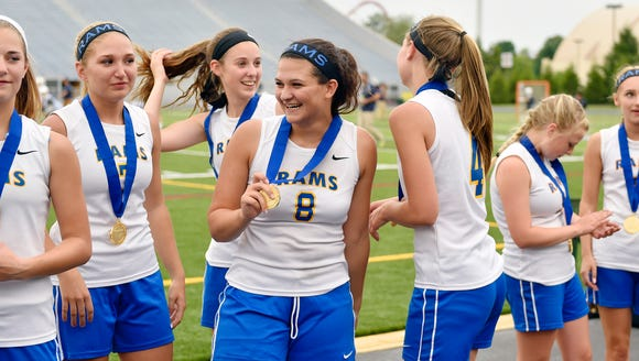 Kennard-Dale's Renee Gering, center, holds her championship