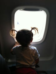 Harper Hughey checks out the view on a flight to Sweden in summer 2012.
