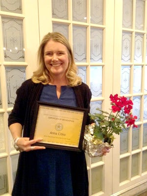 """Anna Citko, a K-4 teacher at Northwest Elementary School in Lebanon, holds a certificate of recognition and flowers she received recently from the Lebanon Valley Association for the Education of Young Children, which named her its 2016 Pre-school Teacher of the Year. Citko, who has been a teacher in the Lebanon School District for 24 years, was chosen for providing creative experiences for children and using many strategies to engage their families. Citko is active with Northwest's  Parents and Teachers Together organization, and demonstrated her professionalism when collaborating with a colleague to present a workshop titled """"Increasing Parent Involvement in the Classroom"""" at a kindergarten transition conference in Feb. 2016."""