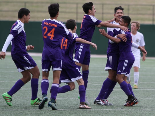 El Paso Eastlake players celebrate their 5-3 overtime