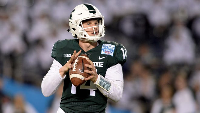 Dec 28, 2017: Michigan State Spartans quarterback Brian Lewerke (14) looks to throw during the first half against the Washington State Cougars in the 2017 Holiday Bowl at SDCCU Stadium.