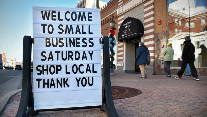 A sign welcomes shoppers to downtown St. Cloud during Small Business Saturday.