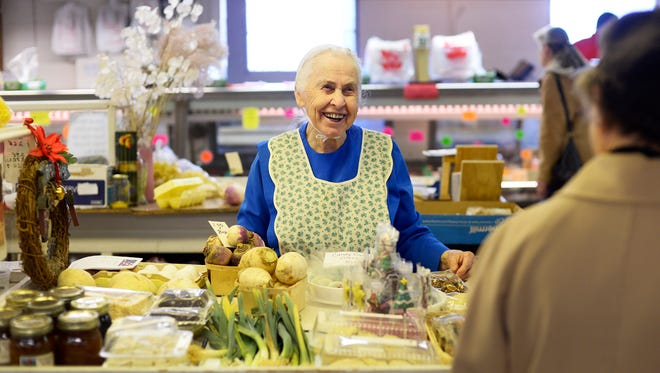 "Dorothy Marks helps a customer at New Eastern Market in Springettsbury Township. Marks opened the stand 60 years ago. Her last day open will be December 31st. ""Well I'm getting slower,"" said Marks on why she was retiring. ""I'm going to miss the people really bad."""