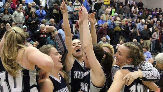 Manasquan players celebrate after they defeated Rutgers Prep during the Tournament of Champions semifinal game played at Pine Belt Arena in Toms River Friday, March 18, 2016.