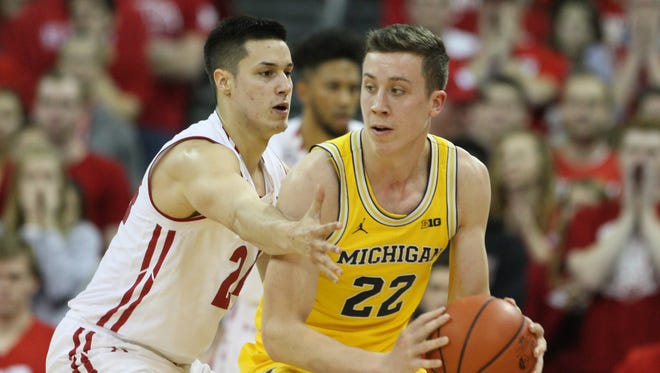 Michigan guard Duncan Robinson looks to pass as Wisconsin guard Bronson Koenig defends during U-M's 68-64 loss on Jan. 17, 2017 in Madison, Wis.