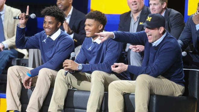 Michigan recruits Donovan Peoples-Jones, Tarik Black and head coach Jim Harbaugh answer questions for fans during the Signing of the Stars event at the Crisler Center in Ann Arbor on Wednesday, Feb. 1, 2017.