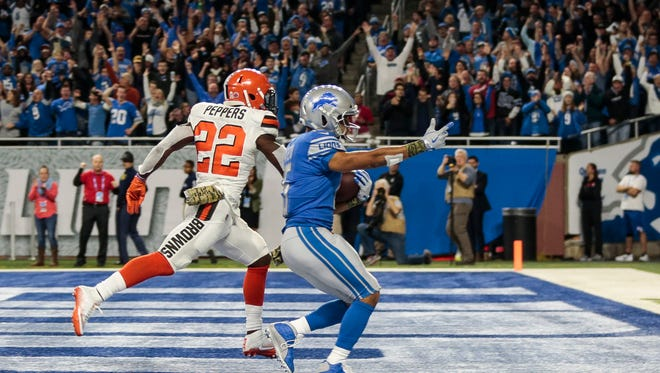 Golden Tate scores a 40-yard touchdown late in the fourth quarter of the Detroit Lions' 38-24 win over the Cleveland Browns at Ford Field, Sunday, Nov. 12, 2017.