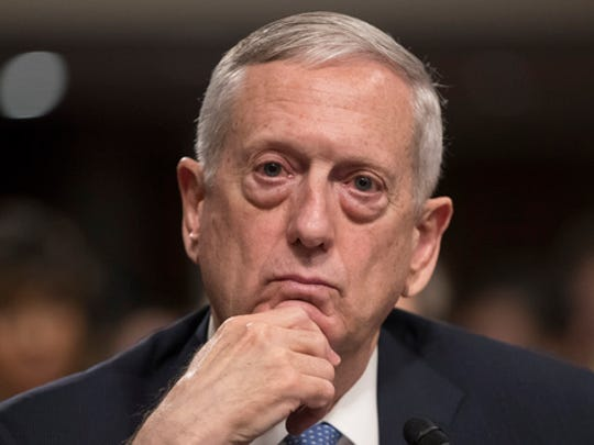 FILE - In this Jan. 12, 2017 file photo, then-Defense Secretary-designate James Mattis listens while testifying at his confirmation hearing before the Senate Armed Services Committee on Capitol Hill in Washington. In a White House with multiple competing power centers, Mattis, Homeland Security Secretary John Kelly and Joint Chiefs Chairman Joseph Dunford are emerging as a new force to be reckoned with. All three are have standing invitations to Trump's working dinners and were influential voices in Trump's decision-making process for a new national security adviser.