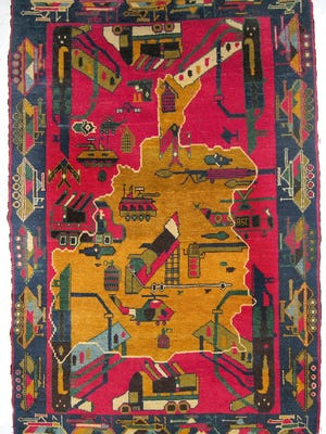 """""""Afghan War Rugs: The Modern Art of Central Asia"""" opens Sunday, Aug. 21, at the Memorial Art Gallery. The show includes 45 rugs, chosen for their content, quality and rarity. Pictured is """"War Rug with Map of Afghanistan"""" in knotted wool."""
