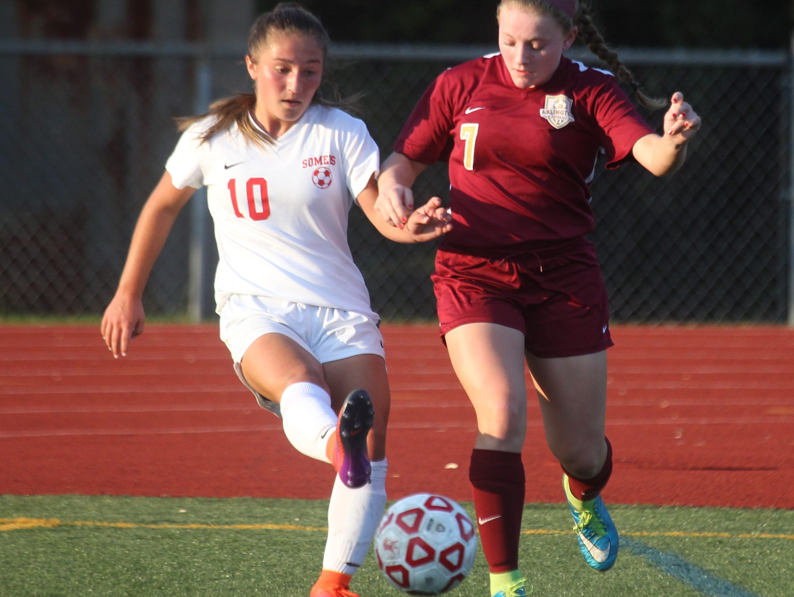 Somers' Jessica Rodriguez, left, is pressured by Arlington's Allie Coon during their game at Somers Oct. 17, 2016. Arlington won 2-1 in overtime.