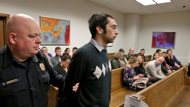 Aaron Ybarra is led into the courtroom prior to being sentenced at Superior Court in Seattle on Wednesday, Nov. 16, 2016. He was sentenced to 112 years in prison.