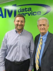 AM Data Service owner Rich Miller with Livonia Mayor