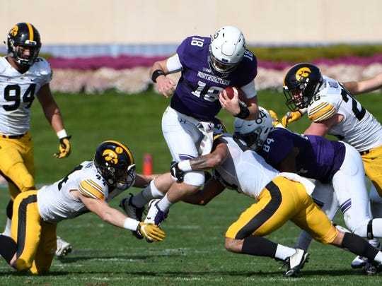 Oct 21, 2017; Evanston, IL, USA; Iowa Hawkeyes linebacker Ben Niemann (44) tries to tackle Northwestern Wildcats quarterback Clayton Thorson (18) during the second half at Ryan Field. Mandatory Credit: David Banks-USA TODAY Sports