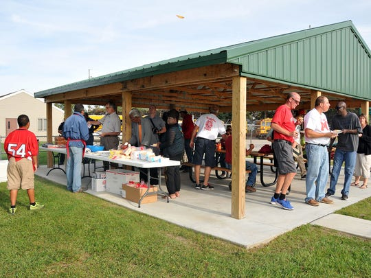 Residents enjoy the new pavilion at the West End Community Park during a cookout on Friday.