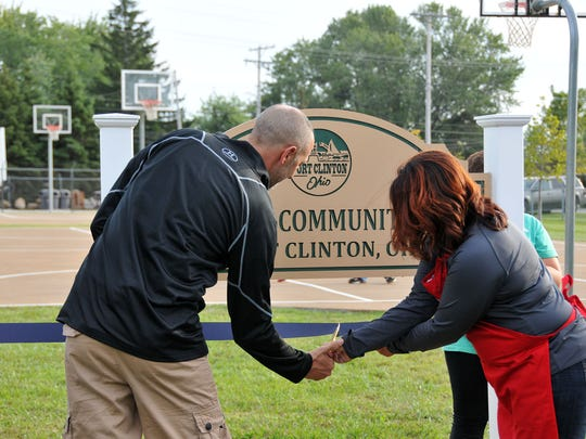 Former councilman Ron Aukerman and current councilwoman Lisa Sarty cut the ribbon for the West End Community Park on Friday evening.