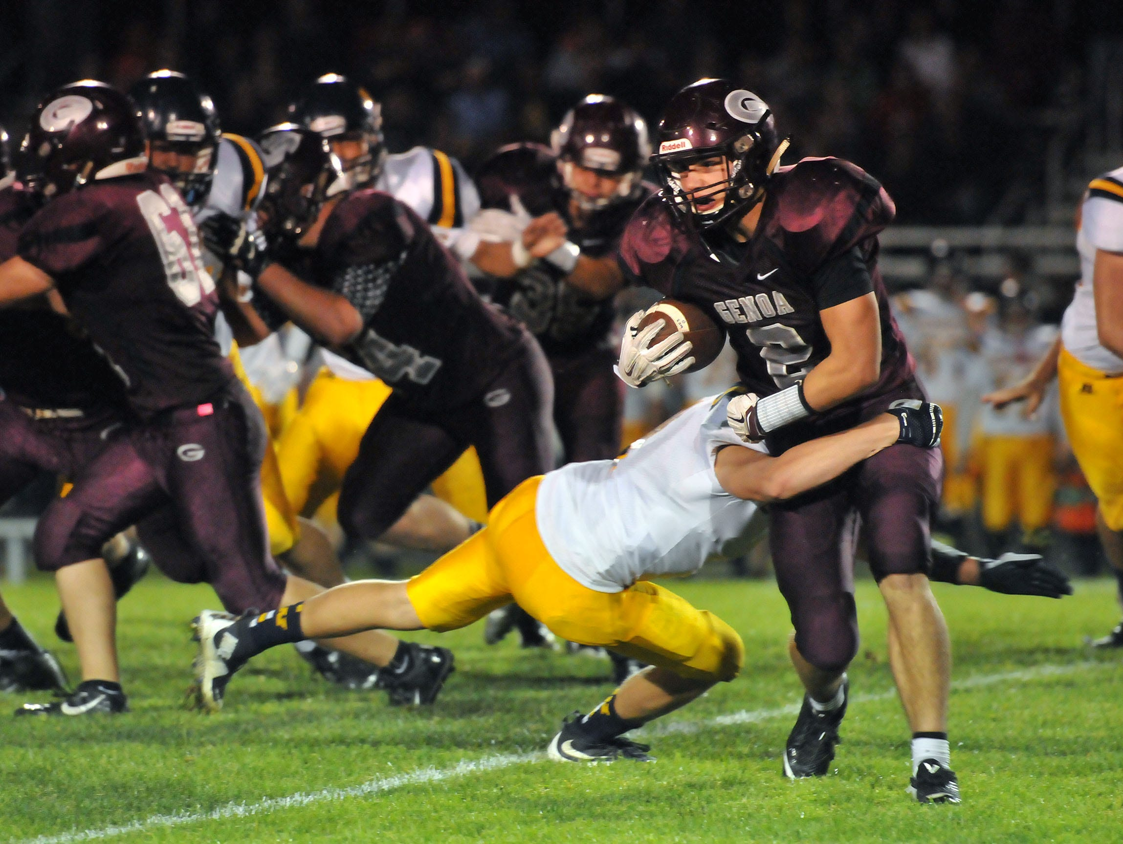 Genoa's Matt Bradfield carries the ball during the Comets home game versus Woodmore on Friday night.