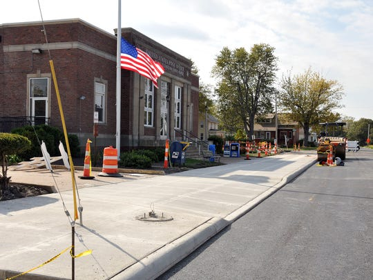 Crews poured and smoothed new sidewalks and blacktop