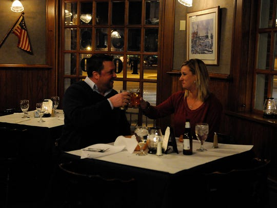 A couple toasts their relationship during Valentine's