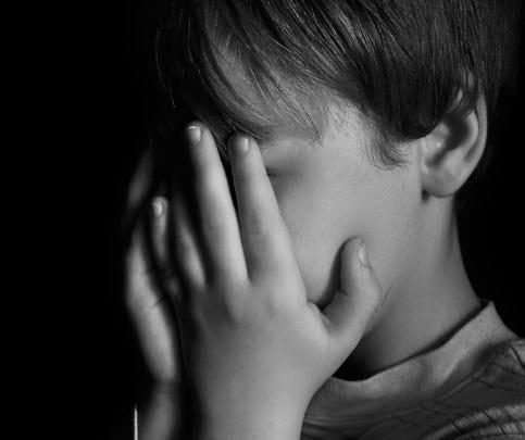 Little boy crying in dark
