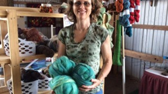 Kristine Baker spun this yarn up for my Miners Hillside Farm shawl. This was taken at last year's Garden State Sheep & Fiber Festival.