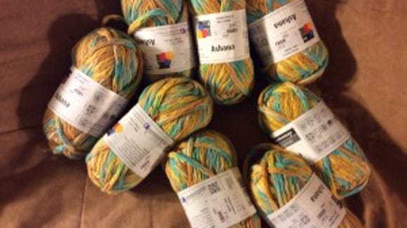 This cotton yarn was on sale for $2 a ball at New England Yarn. It has turquoise in it. How could I resist? Can't decide whether to save it for a sweater or make chemo caps with it.