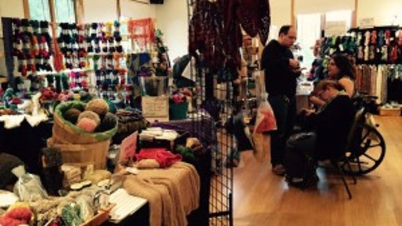 Also in the back room were several independent dyers. The back corner is the MollyGirl corner, and that's where I bought two hanks of yarn.