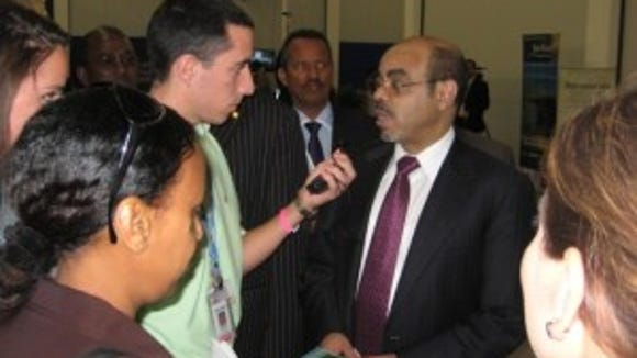 ACS Student Ambassador Anthony Tomaine (York College) interviews Prime Minister of Ethiopia Meles Zenawi at 2010 COP 16 in Cancun, Mexico