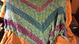 The Bamboo & Corn shawl is almost finished. It will be finished when I have used every bit of yarn that I can use on it.