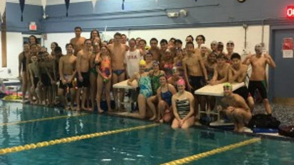 Nic Fink of Morris Twp. and Melanie Margalis (center) gave a swim clinic at the Greater Morristown Y. Photo courtesy of Colin Kostyak.