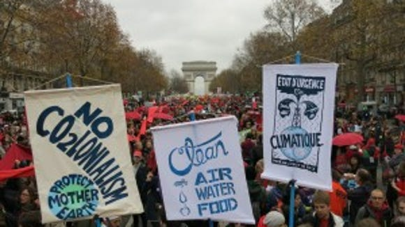 More than 10,000 demonstrated for climate justice in the streets of Paris.