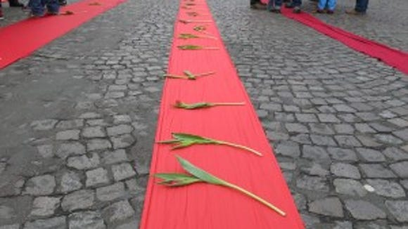 """Multiple red lines were unfurled toward La Défense where """"the real perpetrators of climate crimes in can be found."""""""