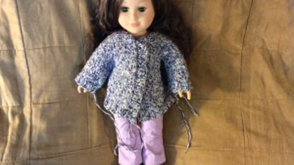 "I decided to keep the jacket I started for Gwen in the photo above. I made the raglan seams a little long and the sweater came out big. It's more like a swing coat then a jacket. My ""My Life"" doll doesn't seem to mind, and I think she's slightly bigger than the American Girl dolls."