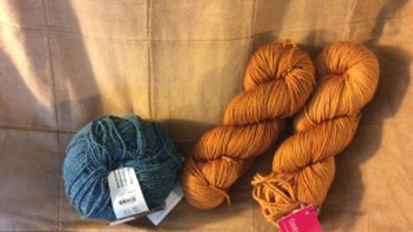 The yarn on the left is the Berroco Remix yarn I got at Knit-a-Bit. The gold yarn on the left is the yarn I bought at Do Ewe Knit?