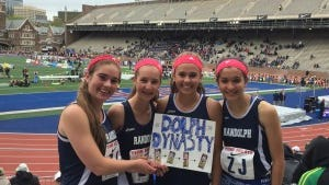Randolph's 4x800 displays a sign made by alumnus Carole Harsch, now a Penn freshman. (Photo by Jane Havsy/Daily Record)
