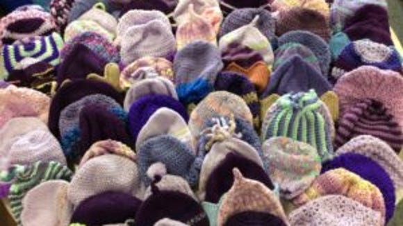 These are purple baby hats submitted by readers in June 2016. Multi-color hats are fine if they are at lest 50 percent purple. Any shade of purple is good.