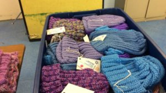 The knitters and crocheters at  Temple B'nai Shalom have bins and bins full of chemo caps and afghans, most of which will be donated to an ocologist's practice for his patients.