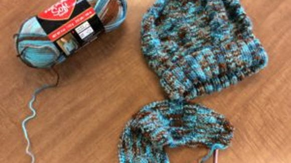 This is my first hat for a food bank this year. Now I am making a scarf to go with it.