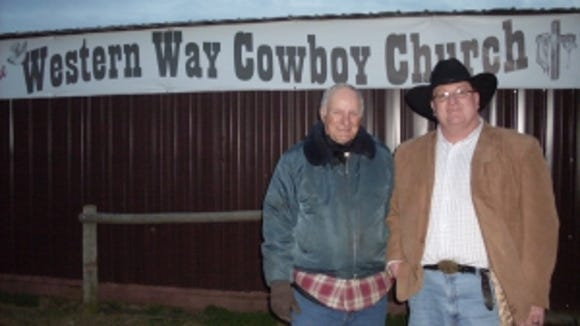 Jensen (left) and Rev. Larry Parvin stand in front
