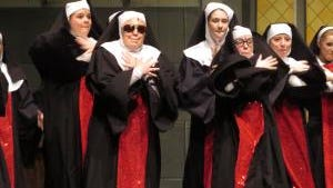 "Sister Mary Lazarus (Sara Coombs) shows her rapping skills in ""Sunday Morning Fever."""
