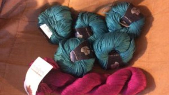 I picked up the five Aria turquoise balls from the clearance rack, along with 7 hanks of Cascade Pima Cotton in that wonderful berry color. The Pima Cotton was not on clearance.