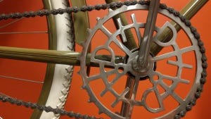 The sprocket of the Harley-Davidson Museum replica of a 1917 Harley bicycle has the H-D logo, just like the original.